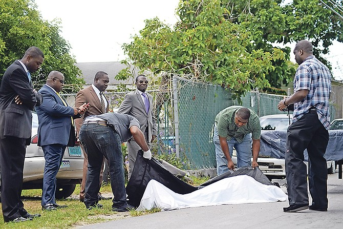The body of the young man who was murdered yesterday in Fox Hill is removed from the scene. Photo: Shawn Hanna