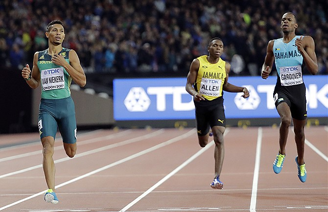 The Bahamas' Steven Gardiner (right) comes in second to South Africa's Wayde Van Niekerk (left) in the men's 400m final at the IAAF World Championships in London. (AP Photo/David J. Phillip)
