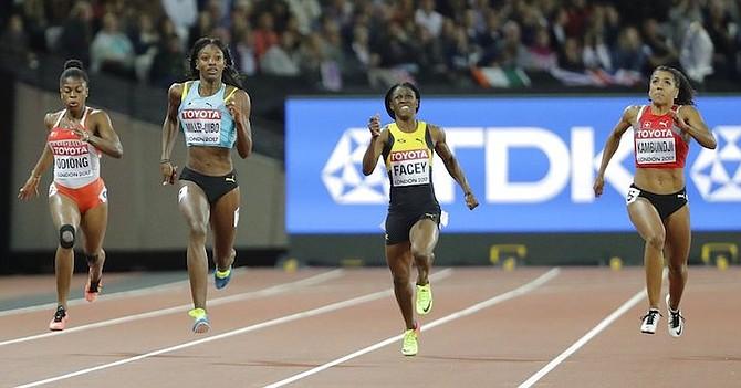 Bahrain's Edidiong Ofonime Odiong, Shaunae Miller-Uibo, Jamaica's Simone Facey and Switzerland's Mujinga Kambundji race in their women's 200m semifinal heat. (AP Photo/David J. Phillip)