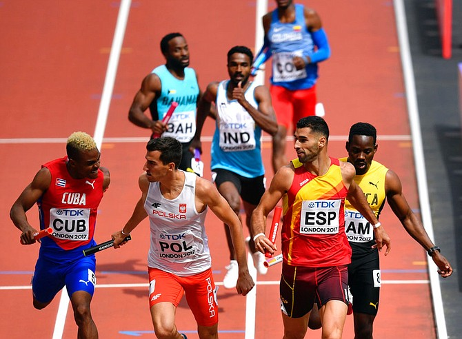 The Bahamas in action in the men's 4x400 relay heats. None of the relays teams managed to qualify. (AP)
