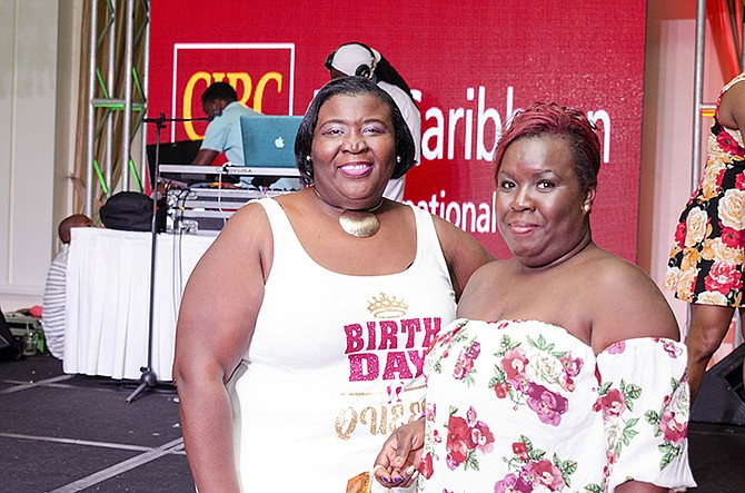 SISTERS Jenell Nairn, left, and Janice Minnis, who lost their sister, Vernique Nairn, to cancer in May, show their support at the CIBC FirstCaribbean Soca Party for the Cure.