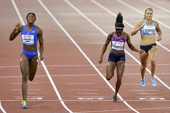 Shaunae Miller-Uibo wins the women's 200m followed by second placed Elaine Thompson of Jamaica, centre, and fourth placed Dafne Schippers of Netherlands, right, during the Weltklasse IAAF Diamond League international athletics meeting in the Letzigrund stadium in Zurich, Switzerland. (Walter Bieri/Keystone via AP)