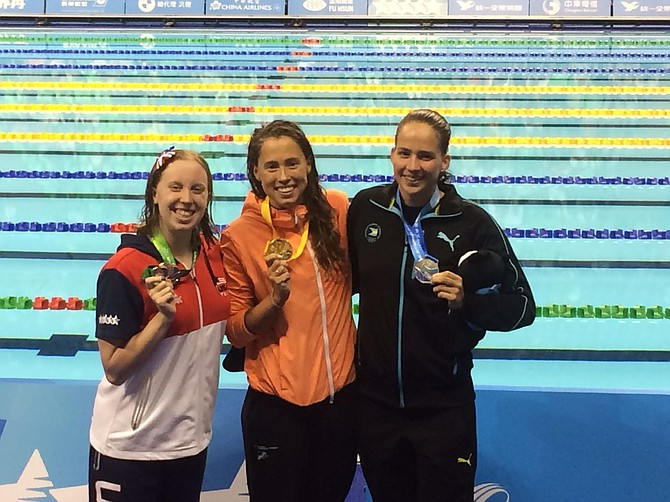 Joanna Evans (right) with one of her medals.