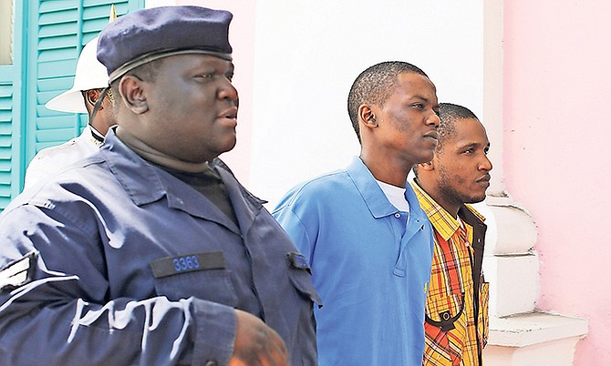Tiano D'Haiti (centre), of Thompson Lane, is accused of murder and attempted armed robbery, while Kevin Andrews, of Montell Heights, is accused of murder, attempted armed robbery and burglary and in connection with the October 28, 2014, incident. Photo: Terrel W. Carey/Tribune Staff