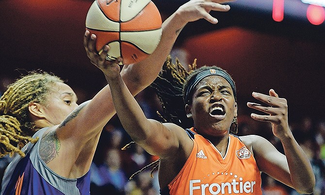 Connecticut Sun centre Jonquel Jones scores around the defence of Phoenix Mercury centre Brittney Griner in the first half of yesterday's WNBA playoffs quarter-final at Mohegan Sun Arena in Uncasville, Connecticut.