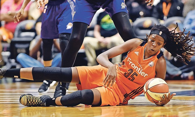 Connecticut Sun centre Jonquel Jones (35) goes to the floor to get the ball in front of Phoenix Mercury centre Brittney Griner (42) in the WNBA basketball playoffs quarter-final on Sunday at Mohegan Sun Arena in Uncasville, Connecticut.
