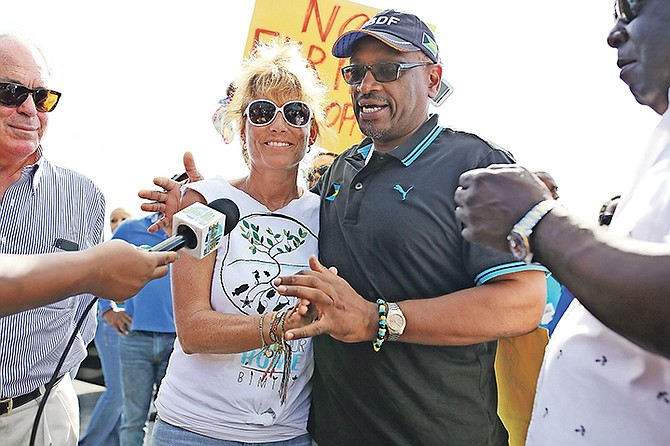 Jenny Cook, spokesperson for Save Our Home, with Prime Minister Dr Hubert Minnis yesterday.