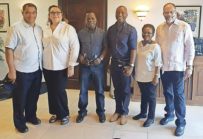 MINISTER of Foreign Affairs Darren Henfield (third right) hosted a small luncheon for CARICOM Chairman and Grenada Prime Minister Dr Keith Mitchell (third left) on Saturday, September 16 following the delegation's return from Ragged Island where they toured the devastation caused there by Hurricane Irma. Dr Mitchell was accompanied by a number of senior Caribbean Community officials, among them, CARICOM Secretary-General Ambassador Irwin LaRocque (far right). Bahamian Prime Minister Dr Hubert Minnis also attended the luncheon. Pictured from left: Minister of Labour Dion Foulkes; Foreign Affairs Acting Permanent Secretary Donna Lowe; Dr Mitchell; Mr Henfield; Director-General in the Ministry of Foreign Affairs Sharon Haylock and Ambassador LaRocque. Photo: BIS