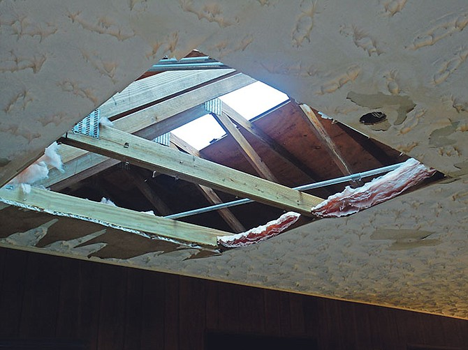 Tornado damage to a ceiling in Grand Bahama.  Photo: Denise Maycock