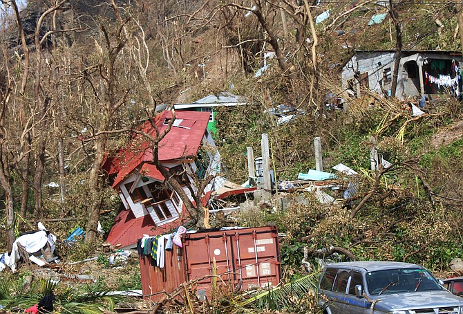 Homes lay scattered after the passing of Hurricane Maria in Roseau, the capital of the island of Dominica, Saturday. (AP Photo/Carlisle Jno Baptiste)