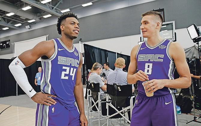 Sacramento Kings' Buddy Hield, left, and Bogdan Bogdanovic talk during the NBA team's media day on Monday in Sacramento, California.  (AP Photo/Rich Pedroncelli)
