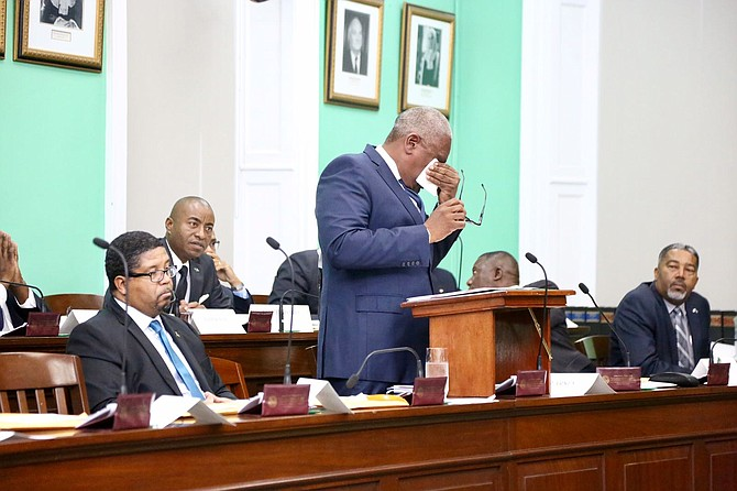Prime Minister Dr Hubert Minnis wipes away tears in the House of Assembly. Photo: Terrel W Carey/Tribune staff