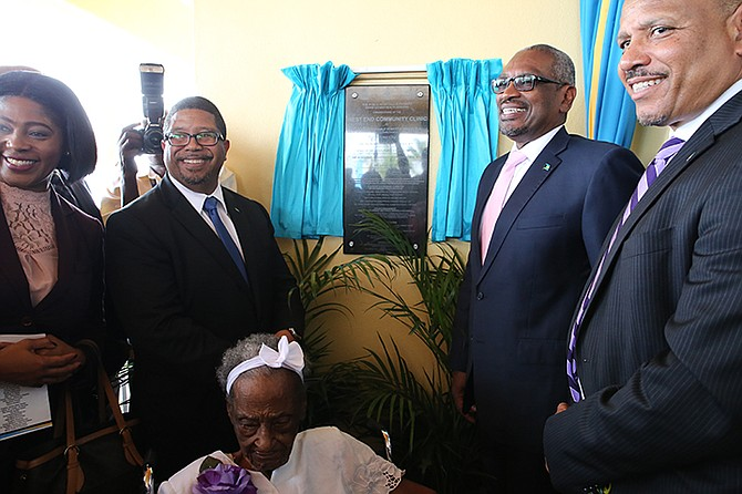 Prime Minister Dr. Hubert Minnis, was in West End, Grand Bahama on Friday for the Commissioning of the West End Community Clinic. Shown from left are: Pakesia Parker-Edgecombe, Parliamentary Secretary for Information and Communications in the Office of the Prime Minister and MP for West Grand Bahama and Bimini; K. Peter Turnquest, Deputy Prime Minister and Minister of Finance; Prime Minister Dr Hubert Minnis; and Minister of Health, Dr. Duane Sands. Seated is the oldest resident of West Grand Bahama, 99-year-old Aleisha Thompson.  (BIS Photo/Lisa Davis)