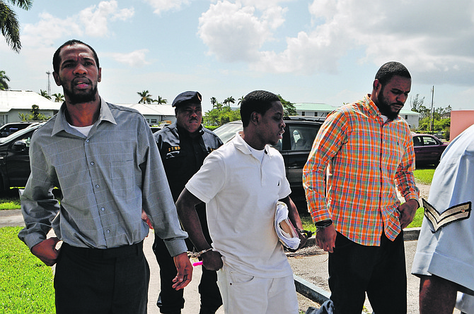 Pictured are the three men accused of the double slaying of a Grand Bahama couple. Seen being escorted from the Supreme Court in Grand Bahama yesterday are (from left) Kevin Dames, Devaughn Hall and Paul Belizaire. Murder charges were dropped against Allan Alicime and Virgill Hall, who accepted a plea deal with the Office of the Attorney General to testify as witnesses for the Crown. Hall and Alicime were convicted of armed robbery and are currently serving time in prison. Photo by Vandyke Hepburn.