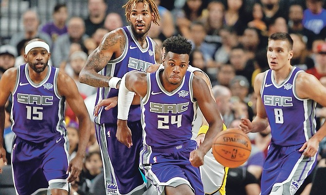 Kings guard Buddy Hield (24) eyes a loose ball with teammates during Sunday's preseason game at the T-Mobile Arena in Las Vegas. (AP)