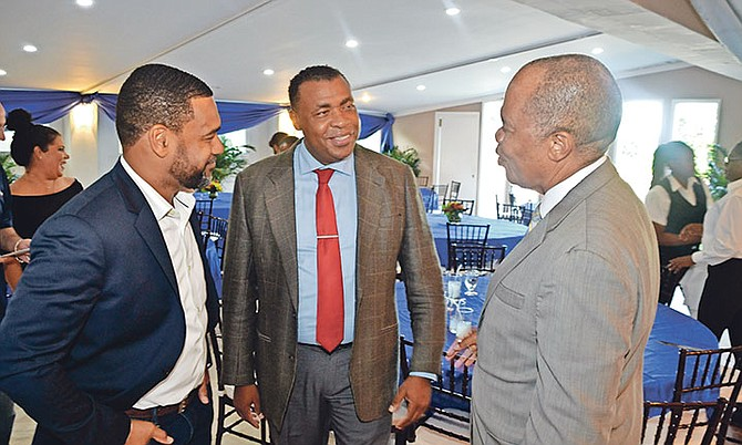Marcus Laing and Carlos Hepburn with former Managing Director of the Public Hospitals Authority Herbert Brown. Photo: Zhivago McPhee – Head of Audio/Visual Department PHA
