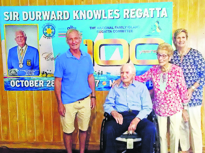 Sir Durward Knowles is flanked by his wife Holly and two of his children Randy and Charlotte Knowles.