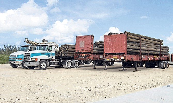 Utility vehicles belonging to Bahamas Power and Light Company Ltd, along with utility poles and lumber, were loaded onto the Royal Bahamas Defence Force craft HMBS Lawrence Major for restoration efforts on Ragged Island. Photo: RBDF Public Relations