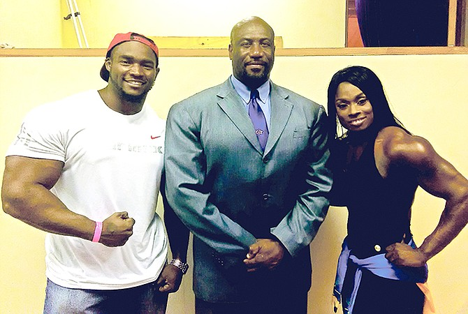 BBFF president Joel Stubbs pose with new professional bodybuilders Jamiel Hamilton and Lakeisha Miller.