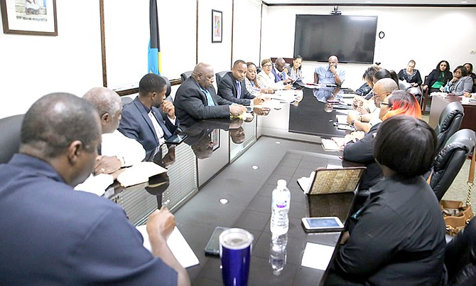 A final planning session at the Office of the Prime Minister, Grand Bahama, before the summit's opening on Thursday.