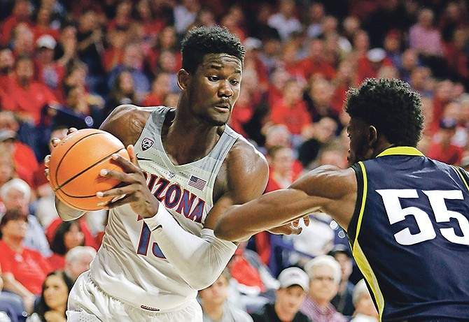 Arizona forward Deandre Ayton (13) can be seen in the first half of Friday's NCAA college game against Northern Arizona in Tucson, Arizona.