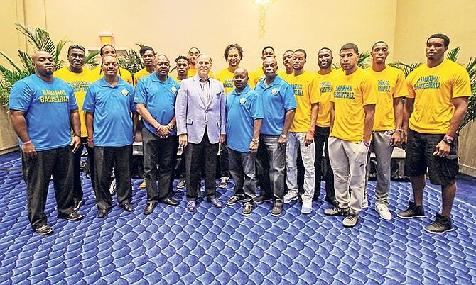 Bahamas men's national team pose above with Baha Mar's president Graeme Davis. Photo: John Marc-Nutt.