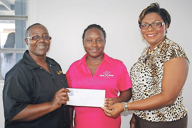 (l-r) BTVI Cafeteria co-operator Mary Laurenceau, the Cancer Society of the Bahamas transportation attendant Jacqueline Cash, and BTVI's assistant vice president of Fund Development, Alicia Thompson. (Photo/Shantique Longley)
