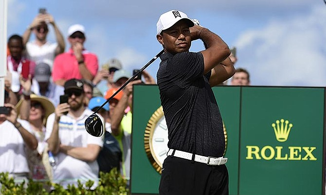 Tiger Woods tees off on the first hole at the Hero World Challenge golf tournament at Albany Golf Club in Nassau, Bahamas, Thursday. (AP Photo/Dante Carrer)