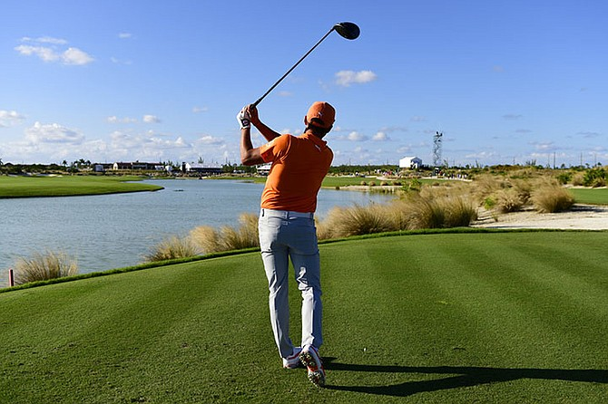 Rickie Fowler watches his shot from the 18th tee during the final round of the Hero World Challenge golf tournament at Albany Golf Club in Nassau, Bahamas, Sunday. Fowler won the tournament. (AP Photo/Dante Carrer)