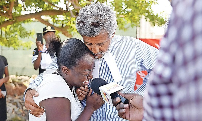 Attorney Fred Smith with Clotilde Jean-Charles, sister of Jeanrony Jean-Charles, who is said to be missing from the Detention Centre. Photo: Shawn Hanna/Tribune Staff
