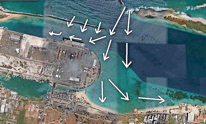 NO SWELL TIME – Aerial photo reveals Nassau Harbour damage caused by breakwater breach.