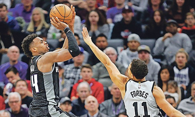 Sacramento Kings guard Buddy Hieldshoots over Spurs' Bryn Forbes (11) during the second half on Saturday. The Spurs won 108-99.