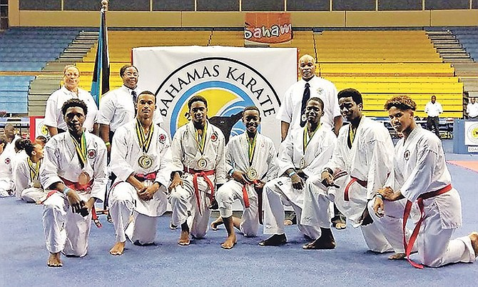 The national senior and junior team members with their coaches. Photo: Bahamas Karate Federation