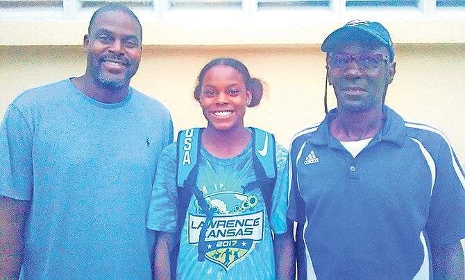 Coach Peter Pratt (right) poses with triple jumper Jasmine Moore and her father Earl Moore.