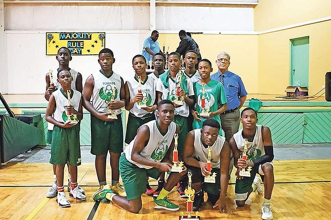CHAMPIONS: Akhepran Academy junior boys completed a perfect run through their division to successfully defended their title in the fifth annual Freedom Baptist Academy Majority Day Rule Basketball Tournament yesterday at the Anatol Rodgers Gymnasium.  Photos: Terrel W Carey/Tribune Staff