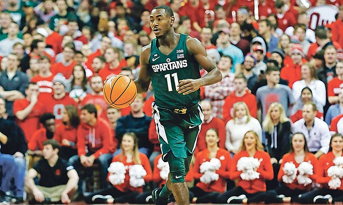 Michigan State guard Lourawls Nairn Jr drives against Ohio State during Sunday's NCAA game in Columbus, Ohio. Ohio State won 80-64. (AP)