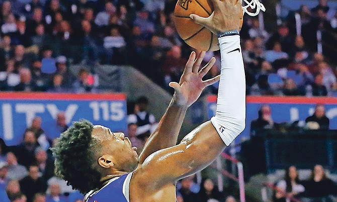 Sacramento Kings guard Buddy Hield (24) shoots in front of Oklahoma City Thunder forward Paul George, right, in the second quarter of last night's game in Oklahoma City.