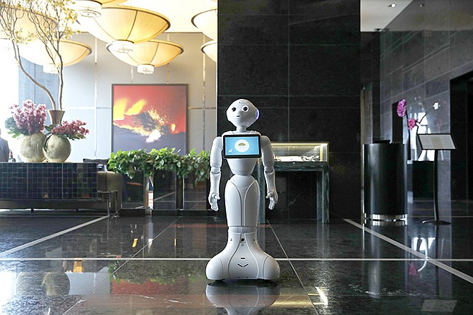 A robot named Pepper stands in the lobby of the Mandarin Oriental in Las Vegas. (AP)