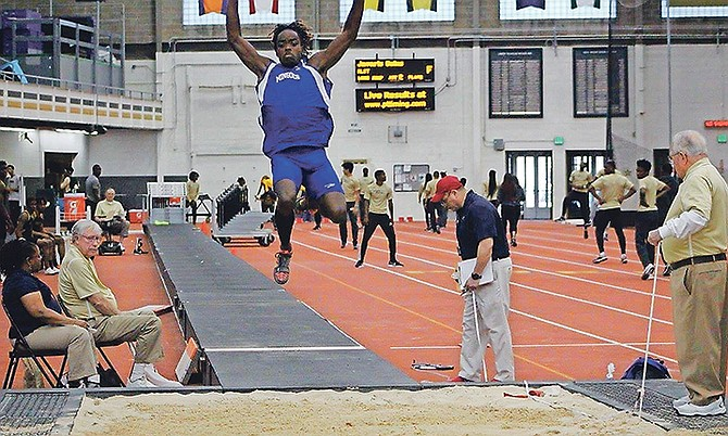 Ken Mullings in action in the long jump.