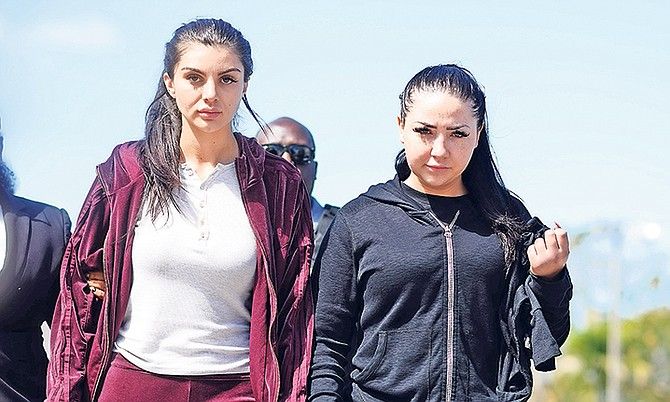 Sydney Mills and Natasha Stolove outside court yesterday where they faced fraud charges. Photos: Shawn Hanna/Tribune Staff