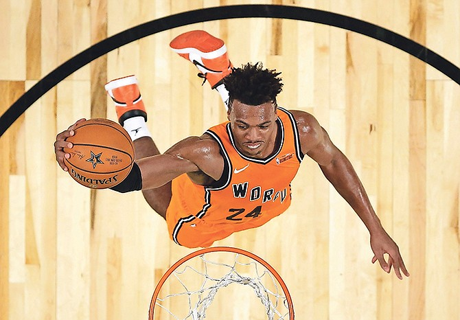Buddy Hield goes up for a dunk during the All-Star Rising Stars game.