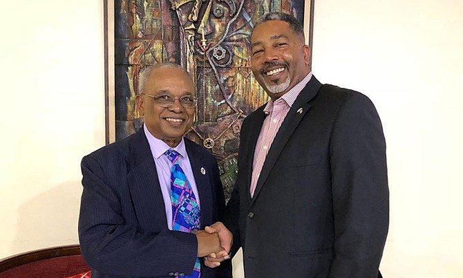 Minister of Transport & Local Government Frankie Campbell (right) is pictured being greeted by Bahamas Ambassador to the Republic of Haiti Jeffrey Williams. (Photo/Yontalay Bowe, OPM Media Services)
