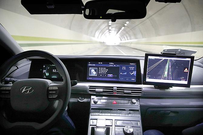 Hyundai's autonomous fuel cell electric vehicle Nexo is driven through a tunnel near the Pyeongchang Olympic Stadium in Pyeongchang, South Korea. (AP Photo/Jae C. Hong)