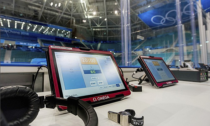 A timing-bench-and-whistle-detection-system, at the Gangneung Hockey Center in Gangneung, South Korea. Real-time player and puck tracking is being tested at the Olympic men's and women's hockey tournaments. In addition to microchips in jerseys and cameras installed in the two hockey arenas, referees' whistles are connected to the clock so that it stops immediately without additional human assistance. (OMEGA via AP)