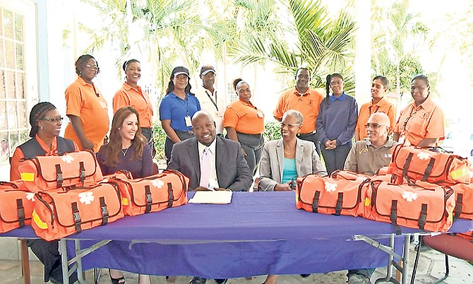 Seated from left, front row: Dr Alvery Hanna, NEMS director; Michele Moodie, VP Ports International; Julian Rolle, chairman PHA; Catherine Weech, PHA managing director, Ollie Dupuch Ferguson, COO Tribune. Standing back row: NEMS Staff.