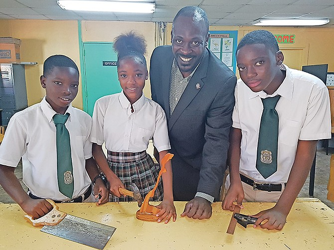 PRINCIPAL of LW Young Jr High School Stephen McPhee with students in the school's technical