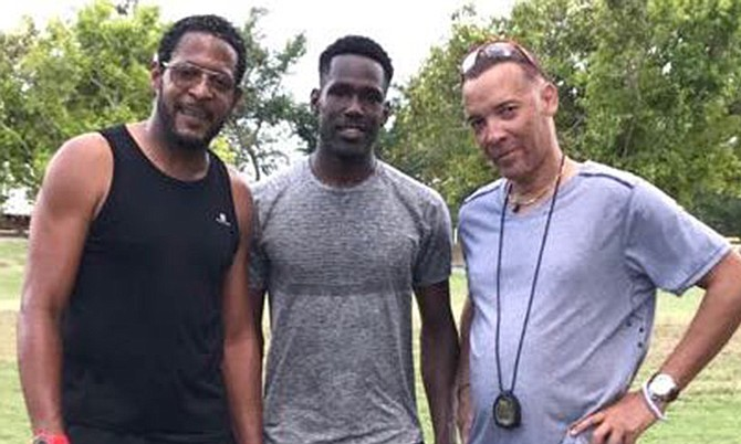 Bahamian Donald Thomas flanked by Cuban world record holder Javier Sotomayor (left) and his coach Luis Pinilo (right) at a training session in Cuba.