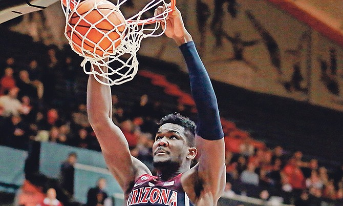 ABOVE THE RIM: Arizona's Deandre Ayton (13) gets behind the Oregon State defence for a dunk on February 22. Ayton has been selected to the AP All-Pac-12 team.