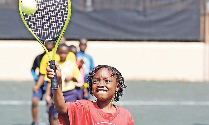 An aspiring tennis star enjoys the Impact Tennis Academy's pilot programme. The 3rd grade students of Centreville Primary were treated to a full day of activities at the Balmoral Club Tennis Courts on Sandford Drive.