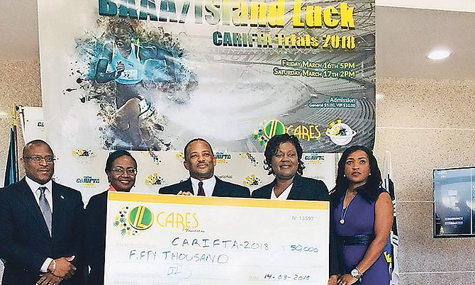 SHOWN (l-r) are Minister of Youth, Sports and Culture Michael Pintard, BAAA President Rosamunde Carey, Island Luck CFO Dirk Simmons, LOC CFO Natasha Adderley and LOC Co-Chair Tonique Williams.